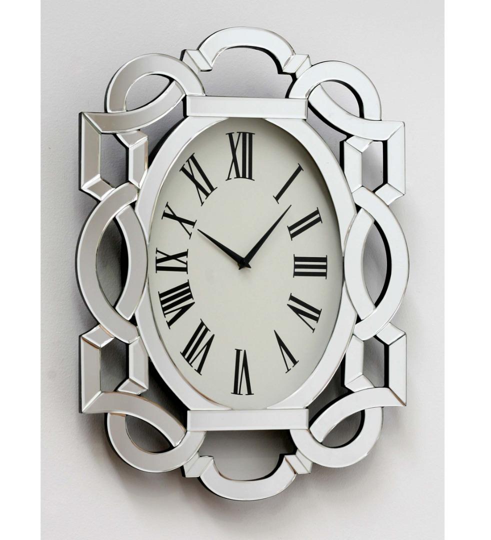 reloj de paret ovalado