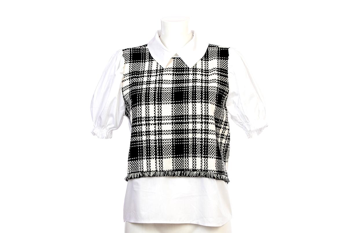 Blusa de punto a cuadros blanco y negro